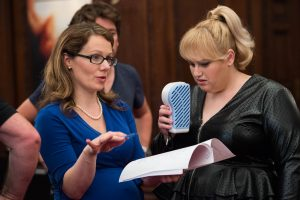 Screenwriter Dana Fox chats with Rebel Wilson during production on the set of How To Be Single