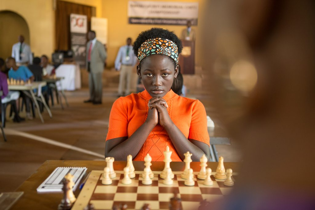 Madina Nalwanga is Phiona Mutesi in Queen of Katwe, the true story of a young girl from the streets of rural Uganda whose world rapidly changes when she is introduced to the game of chess. Photo courtesy: Disney Pictures