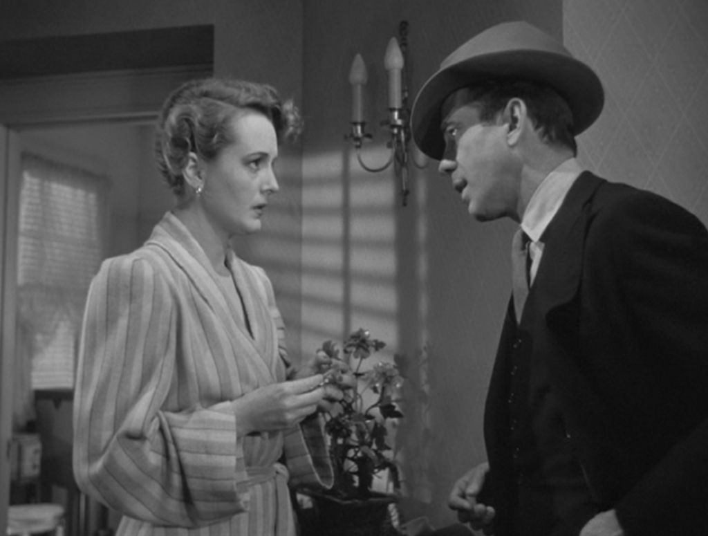 Humphrey Bogart speaks to Mary Astor wryly in The Maltese Falcon. Photo Courtesy: Warner Bros